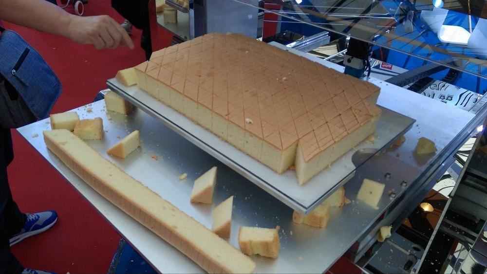 自动蛋糕切割机主要应用于蛋糕加工的切片机