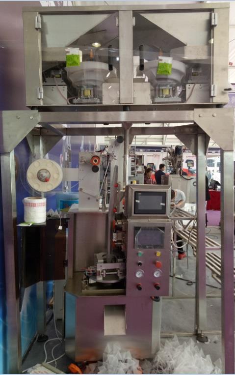 Full automatic electronic sacle triangle tea-bag packing machine.jpg