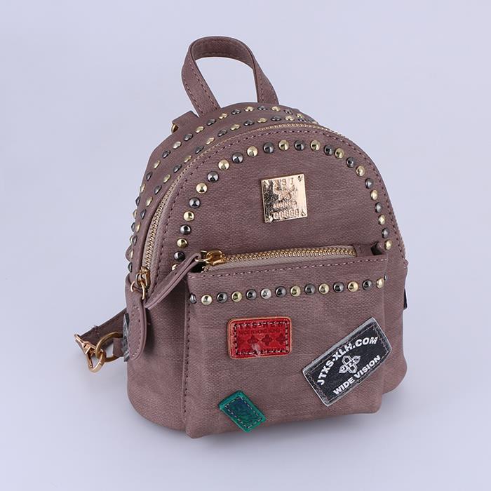 Fashion wild badge rivet shoulder mini backpack.JPG
