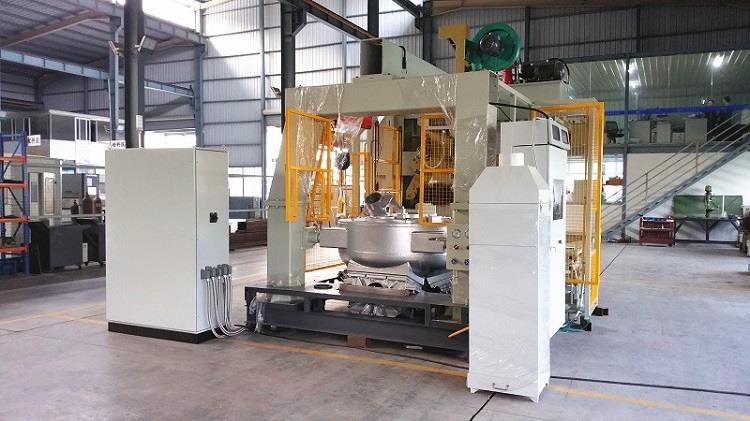 Gravity die casting machine for brass